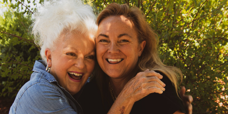 Two women hugging eachother and smiling